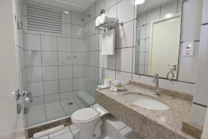 A bathroom at Gran Lençóis Flat Residence