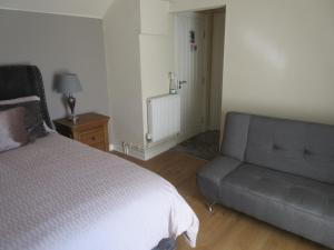 A bed or beds in a room at Anchor House
