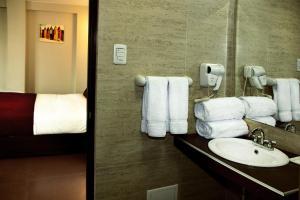 Un baño de Hoteles Riviera Mansion