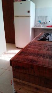 A kitchen or kitchenette at Casa Nova Ótima Escolha
