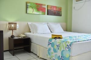 A bed or beds in a room at Gran Lençóis Flat Residence