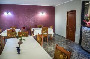 Un restaurant sau alt loc unde se poate mânca la Pensiunea Christiana