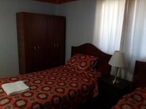 A bed or beds in a room at Cabañas Prado Verde