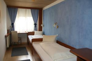 Ein Bett oder Betten in einem Zimmer der Unterkunft Cityhotel Schwarzer Bär Innsbruck