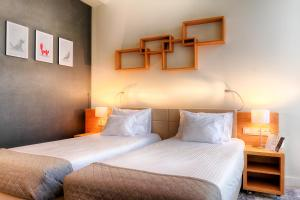 A bed or beds in a room at Focus Hotel Premium Sopot