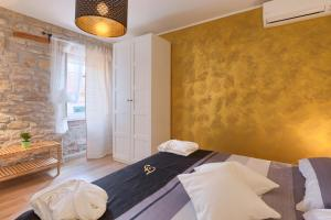 A bed or beds in a room at Luxury Apartment Fabris