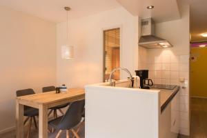 Küche/Küchenzeile in der Unterkunft Kaap appartementen