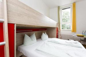 A bed or beds in a room at Jugendherberge Bonn