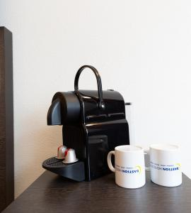 Coffee and tea-making facilities at Bastion Hotel Schiphol Hoofddorp