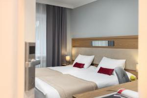 Кровать или кровати в номере Покровский Посад