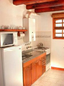 A kitchen or kitchenette at Cabañas Mirasoles