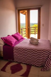 A bed or beds in a room at Cabañas Mirasoles