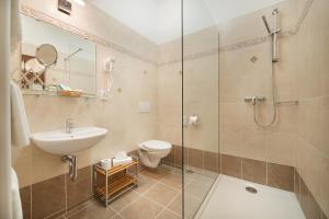 Koupelna v ubytování Brioni Suites