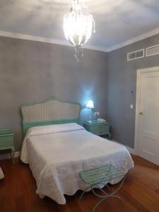 Un ou plusieurs lits dans un hébergement de l'établissement Le Petit Paris