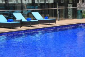 The swimming pool at or near Maroko Bayshore Suites