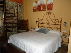 Cama o camas de una habitación en Hostal Casa Laure y Mª Jose