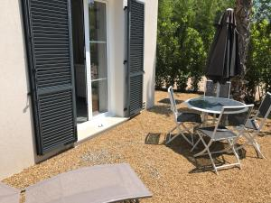A porch or other outdoor area at Windward