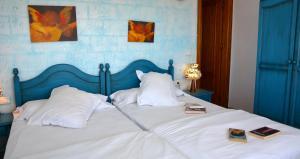 Säng eller sängar i ett rum på Hotel Al-Andalus
