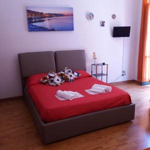A bed or beds in a room at Affaccio Salerno