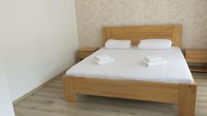 Postel nebo postele na pokoji v ubytování Apartment on Krymska
