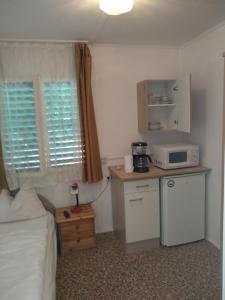 Kuchyň nebo kuchyňský kout v ubytování Tulipan Bungalow Camping Resort