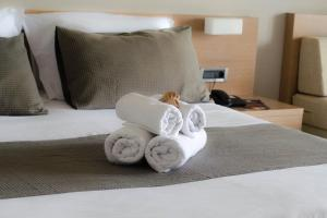 A bed or beds in a room at Nautilus Bay Hotel
