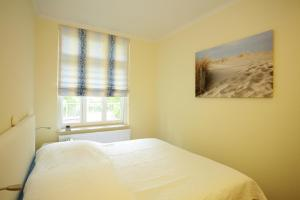 Ein Bett oder Betten in einem Zimmer der Unterkunft Kurpark-Oase
