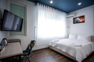 Giường trong phòng chung tại LeBlanc Saigon