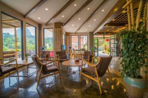 Restaurant ou autre lieu de restauration dans l'établissement The Bamboo Leaf Yangshuo
