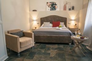 Letto o letti in una camera di Villa La Lumia B&B Suites & Apartments