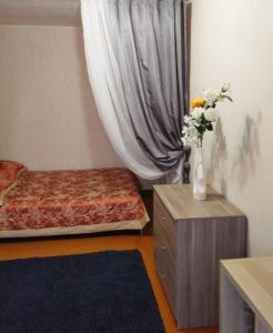 Кровать или кровати в номере Аппартаменты у Алатыря