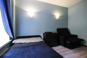 Кровать или кровати в номере Grazhdanskaia ulitsa 10(2)