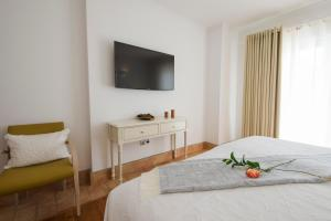A bed or beds in a room at Guarda Rios