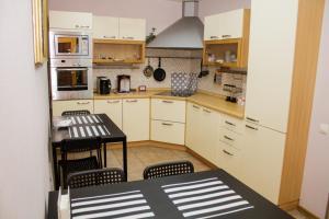 Кухня или мини-кухня в Guest house Annino
