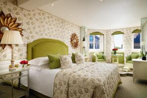 A bed or beds in a room at The Chesterfield Mayfair