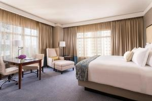 A bed or beds in a room at The Ritz-Carlton, Dallas