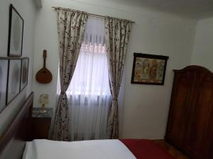 A bed or beds in a room at Santino Apartment