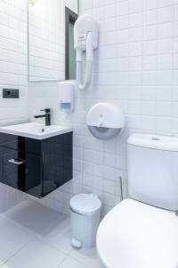 Ванная комната в Алекс Отель на Мужества