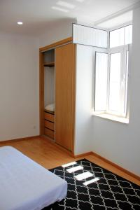 A bed or beds in a room at Coimbra - Portagem
