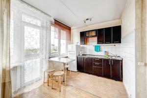 Кухня или мини-кухня в Апартаменты на Ленинградском проспекте 33А