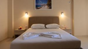 A bed or beds in a room at Villa Balani