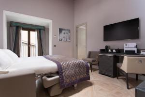 Un ou plusieurs lits dans un hébergement de l'établissement Hotel Spadai