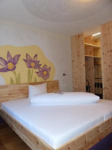 Ein Bett oder Betten in einem Zimmer der Unterkunft Hotel Herrmann