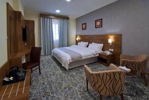 Cama ou camas em um quarto em Delights Inn