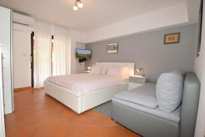 A bed or beds in a room at Apartment Sambris No 1