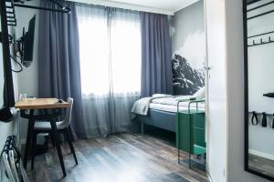 A bed or beds in a room at SPiS Hotel & Hostel