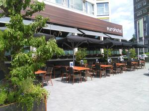 A restaurant or other place to eat at Eurohotel
