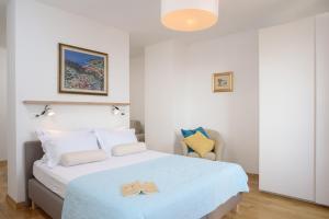 Posteľ alebo postele v izbe v ubytovaní Apartment Divine view