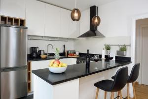 Kuchyňa alebo kuchynka v ubytovaní Apartment Divine view