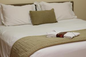Cama ou camas em um quarto em Quality Belo Horizonte Lourdes